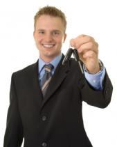 happy salesman with keys